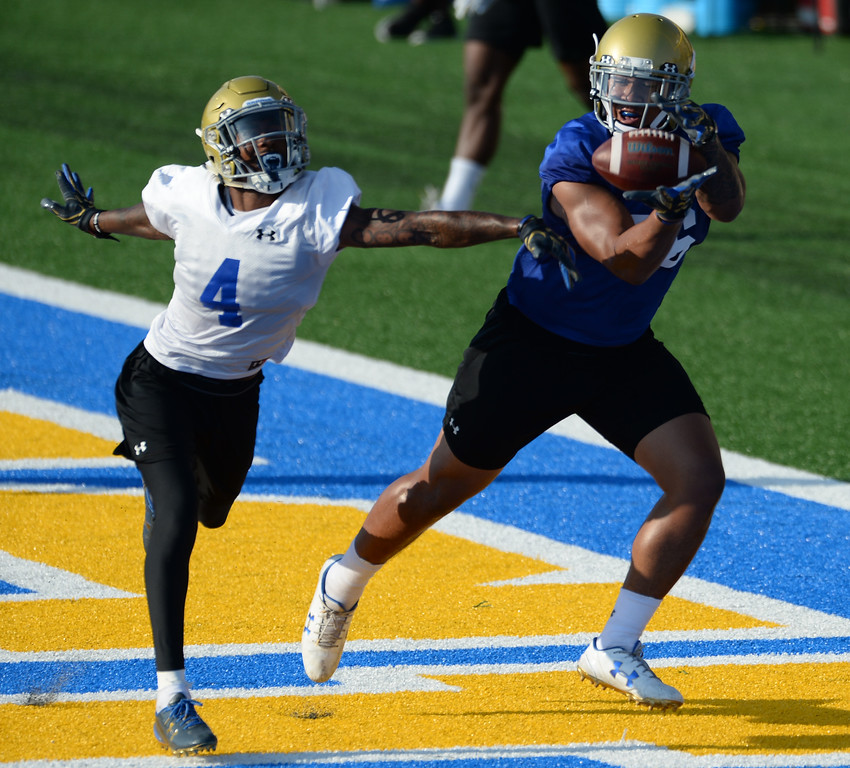 . UCLA\'s Devin Asiasi (86) tries to haul in a pass over Jaleel Wadood (4) during football practice at Spaulding Field on campus Friday, August 04, 2017, Westwood, CA.   (Photo by Steve McCrank, Daily Breeze/SCNG)