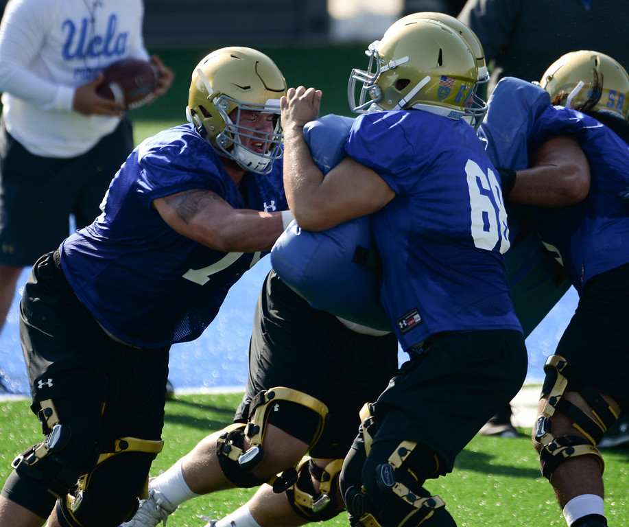 . UCLA offensive linemen Andre James (75) and Clayton Demski (68) hit the pads during football practice at Spaulding Field on campus Friday, August 04, 2017, Westwood, CA.   (Photo by Steve McCrank, Daily Breeze/SCNG)