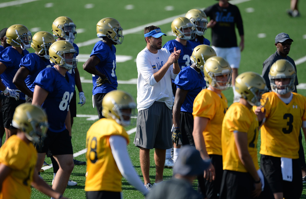 . UCLA receivers coach Jimmie Dougherty, center, applauds his team during football practice at Spaulding Field on campus Friday, August 04, 2017, Westwood, CA.   (Photo by Steve McCrank, Daily Breeze/SCNG)