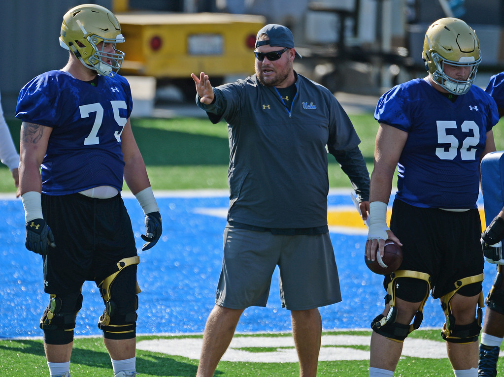 . Offensive line coach Hank Fraley talks to Andre James (75) during UCLA football practice at Spaulding Field on campus Friday, August 04, 2017, Westwood, CA.   (Photo by Steve McCrank, Daily Breeze/SCNG)
