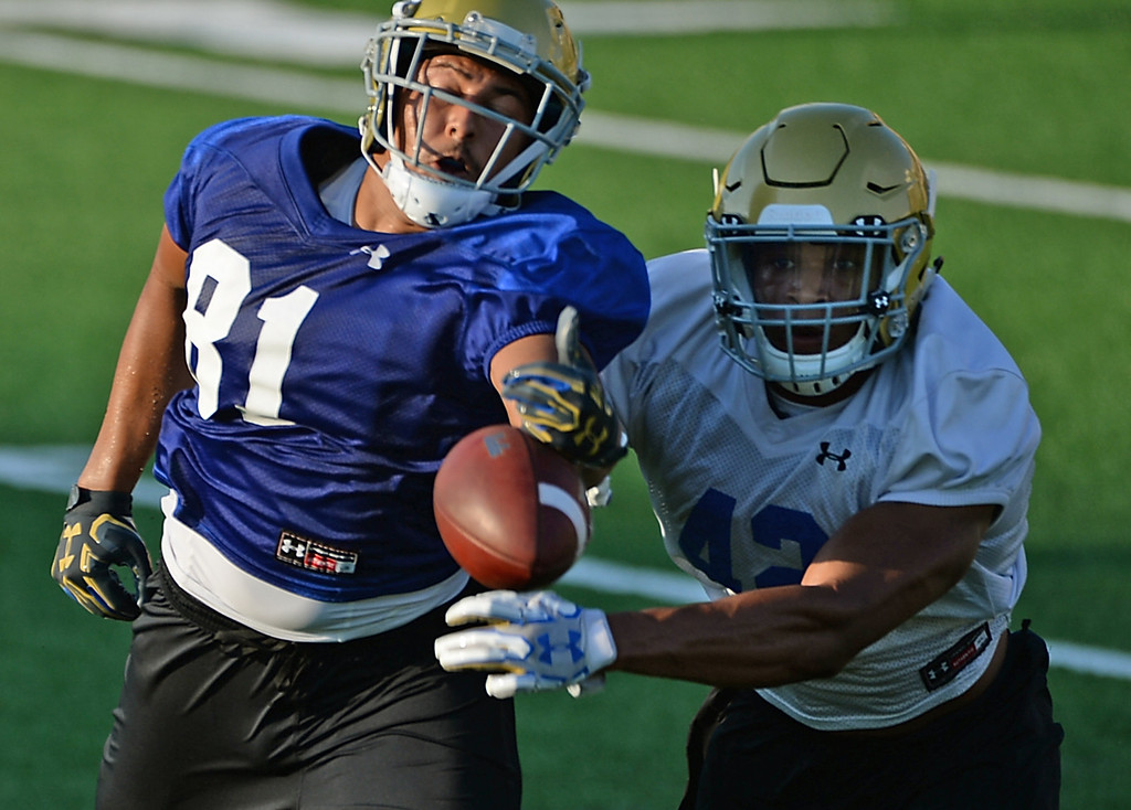 . UCLA\'s Kenny Young (42) breaks up a pass to Caleb Wilson (81) football practice at Spaulding Field on campus Friday, August 04, 2017, Westwood, CA.   (Photo by Steve McCrank, Daily Breeze/SCNG)