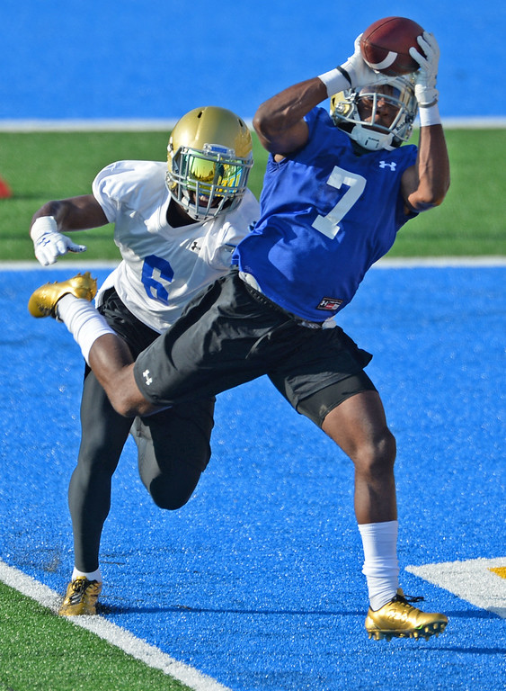 . UCLA\'s Darren Andrews (7) brings down a pass against Adarius Pickett (6) during football practice at Spaulding Field on campus Friday, August 04, 2017, Westwood, CA.   (Photo by Steve McCrank, Daily Breeze/SCNG)