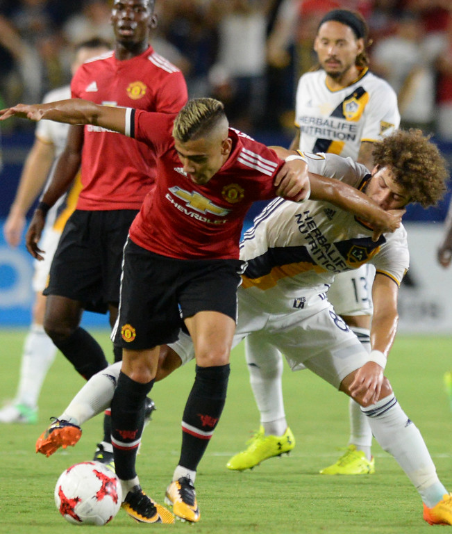 . LA Galaxy\'s Joao Pedro (8) finds it difficult to get around Manchester United\'s Andreas Pereira (15) in an international friendly soccer game at the StubHub Center Saturday, July 15, 2017, Carson, CA.  Manchester won 5-2. (Photo by Steve McCrank, Daily Breeze/SCNG)