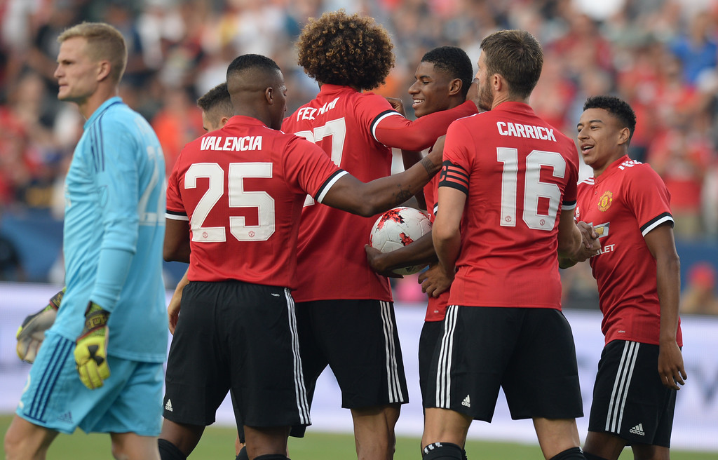 . Manchester United\'s swarms Marcus Rashford (19) as LA Galaxy\'s keeper Jon Kempin (22) walks past with head low after Rashford scored in an international friendly soccer game at the StubHub Center Saturday, July 15, 2017, Carson, CA.  Manchester led 3-0 at halftime. (Photo by Steve McCrank, Daily Breeze/SCNG)