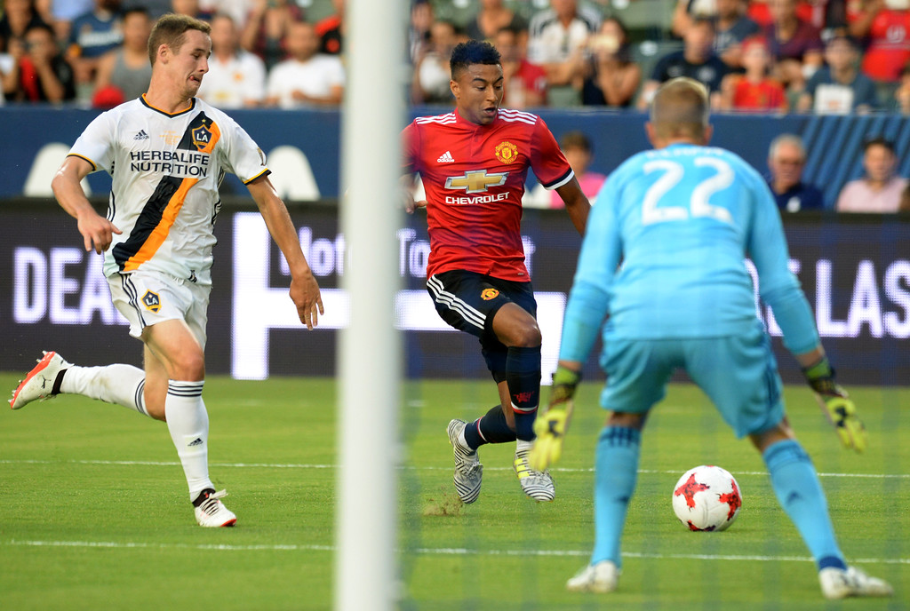 . Manchester United\'s Jesse Lingard (14) challenges LA Galaxy keeper Jon Kempin (22) in an international friendly soccer game at the StubHub Center Saturday, July 15, 2017, Carson, CA.  Manchester led 3-0 at halftime. (Photo by Steve McCrank, Daily Breeze/SCNG)