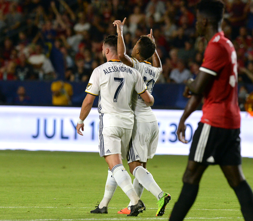 . LA Galaxy\'s Giovani dos Santos (10) celebrates his goal on Manchester United with Romain Alessandrini (7) in an international friendly soccer game at the StubHub Center Saturday, July 15, 2017, Carson, CA.  Manchester won 5-2. (Photo by Steve McCrank, Daily Breeze/SCNG)
