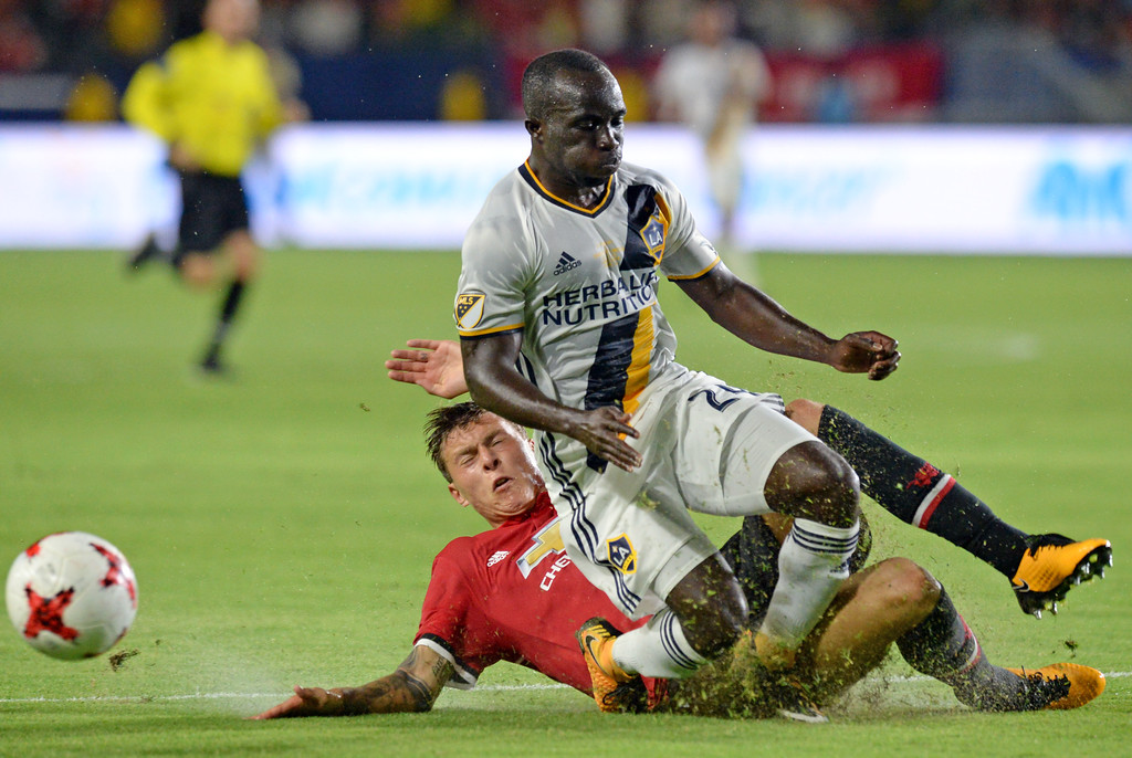 . LA Galaxy\'s Emmanuel Boateng (24) has the ball taken away from behind by Manchester United\'s Victor Lindelof (2) in an international friendly soccer game at the StubHub Center Saturday, July 15, 2017, Carson, CA.  Manchester won 5-2. (Photo by Steve McCrank, Daily Breeze/SCNG)