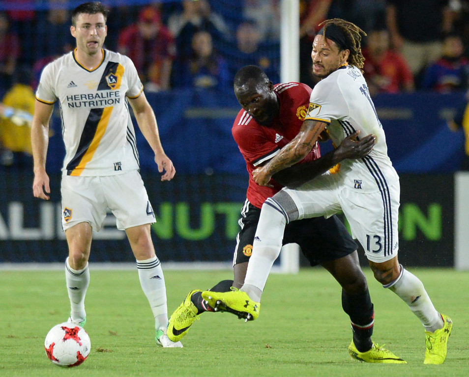 . LA Galaxy\'s Jermaine Jones (13) gets tangled with Manchester United\'s Romelo Lukaku (9) in an international friendly soccer game at the StubHub Center Saturday, July 15, 2017, Carson, CA.  Manchester won 5-2. (Photo by Steve McCrank, Daily Breeze/SCNG)