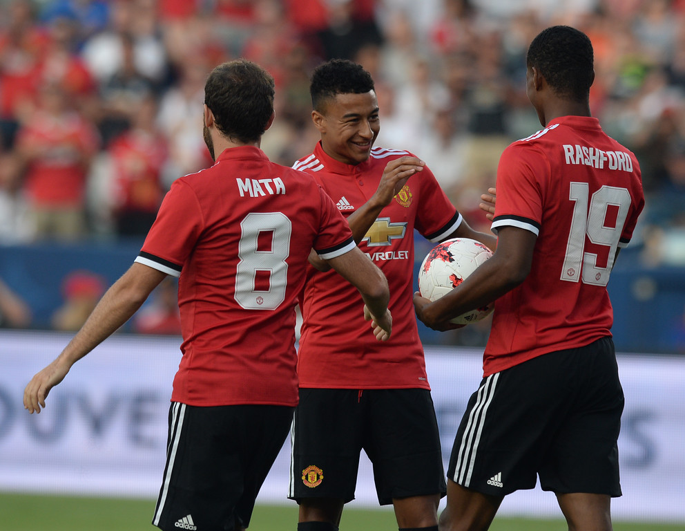 . Manchester United\'s swarms Marcus Rashford (19) after Rashford scored in an international friendly soccer game at the StubHub Center Saturday, July 15, 2017, Carson, CA.  Manchester led 3-0 at halftime. (Photo by Steve McCrank, Daily Breeze/SCNG)