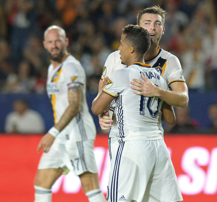 . LA Galaxy\'s Dave Romney (4) is hugged by Giovani dos Santos (10) after Romney scored on after scoring against Manchester United in an international friendly soccer game at the StubHub Center Saturday, July 15, 2017, Carson, CA.  Manchester won 5-2. (Photo by Steve McCrank, Daily Breeze/SCNG)