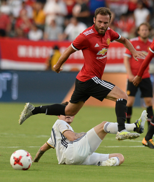. Manchester United\'s Juan Mata (8) avoids a slide tackle from LA Galaxy\'s Raul Mendiola (40) in an international friendly soccer game at the StubHub Center Saturday, July 15, 2017, Carson, CA.  Manchester led 3-0 at halftime. (Photo by Steve McCrank, Daily Breeze/SCNG)
