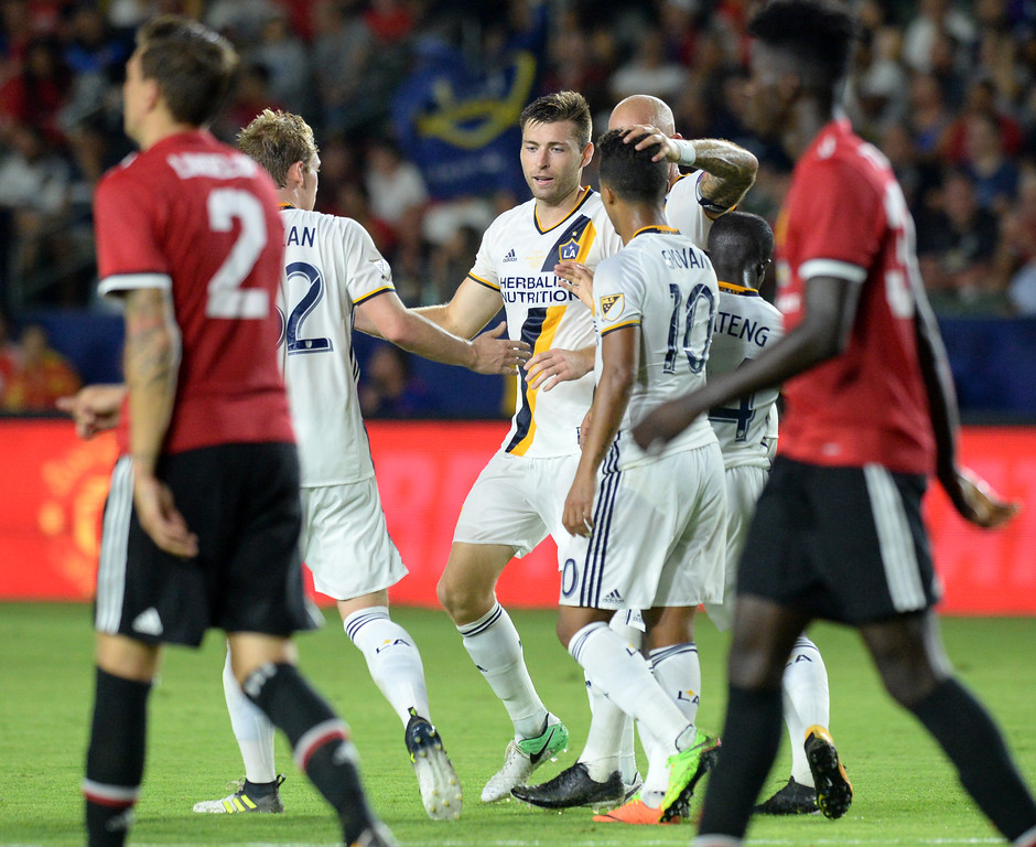 . LA Galaxy\'s Dave Romney (4), center, is met by teammates after scoring against Manchester United in an international friendly soccer game at the StubHub Center Saturday, July 15, 2017, Carson, CA.  Manchester won 5-2. (Photo by Steve McCrank, Daily Breeze/SCNG)