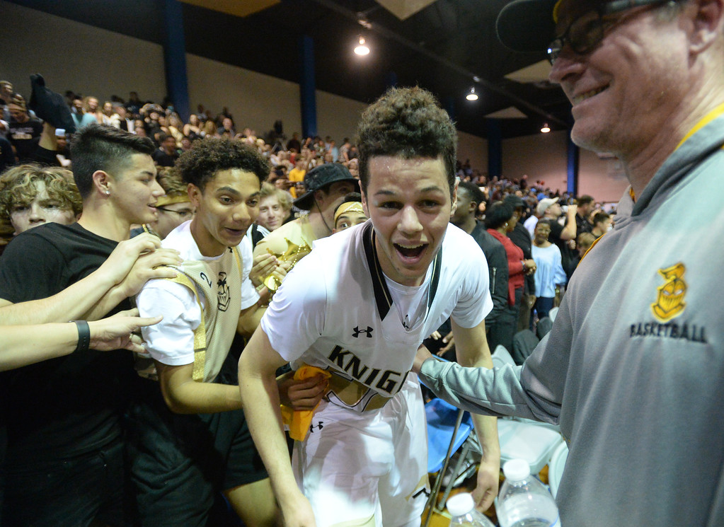. Bishop Montgomery\'s Jordan Schakel (21) is all smiles as the student section cheers with him after beating Chino Hills in a CIF State Open Division boys basketball game played at El Camino College Tuesday, March 14, 2017, Torrance, CA. Bishop Montgomery won 87-80. Photo by Steve McCrank, Daily News/SCNG