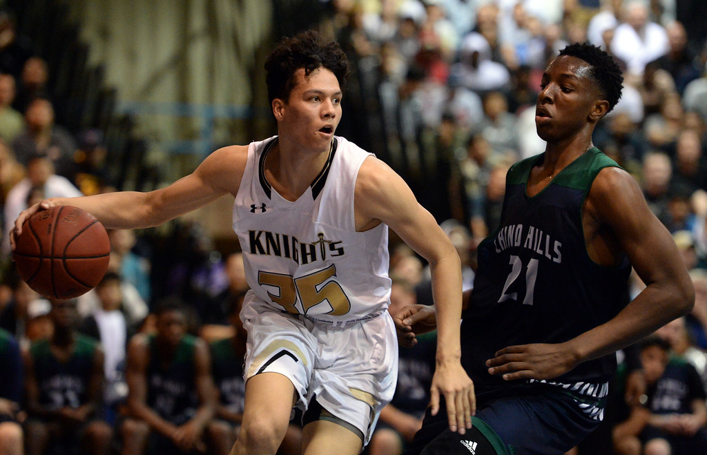 . Bishop Montgomery\'s Fletcher Tynen (5) drives under the basket around Chino Hills\' Onyeka Okongwu (21) in a CIF State Open Division boys basketball game played at El Camino College Tuesday, March 14, 2017, Torrance, CA. Bishop Montgomery won 87-80. Photo by Steve McCrank, Daily News/SCNG