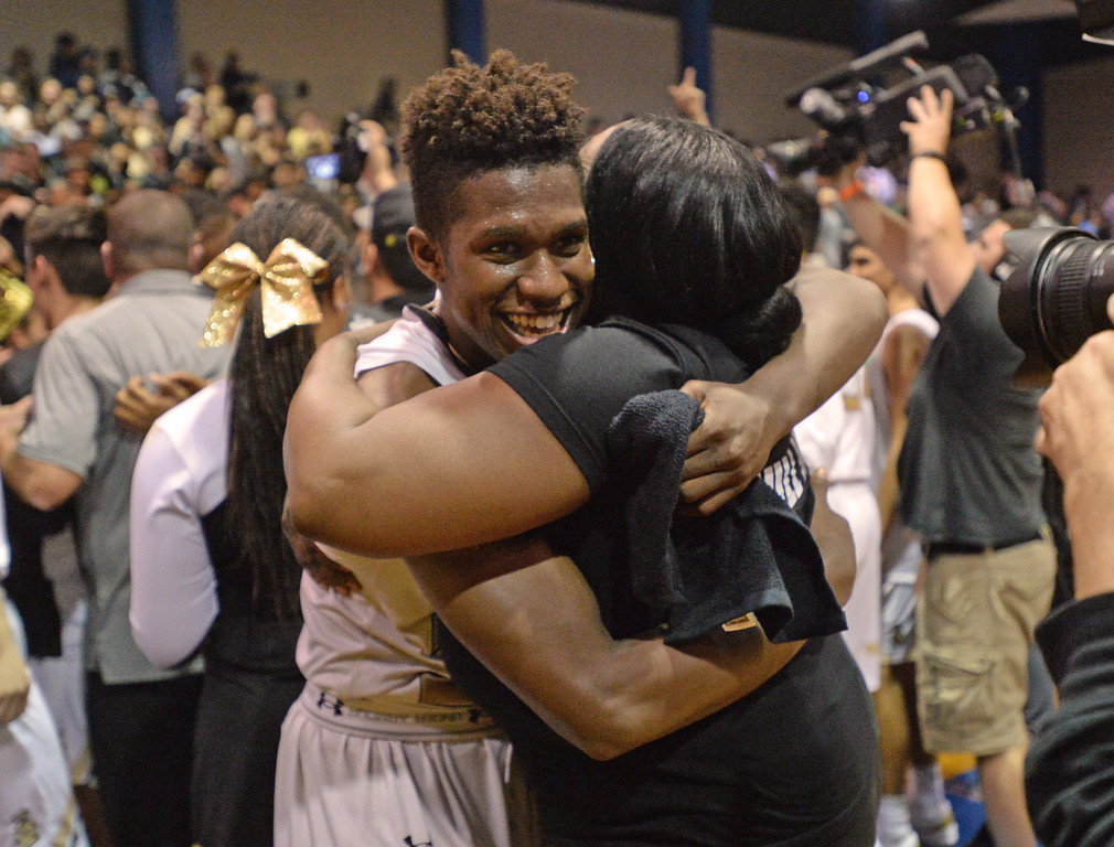 . Bishop Montgomery\'s David Singleton (34) gets hugs after he and his team beat Chino Hills in a CIF State Open Division boys basketball game played at El Camino College Tuesday, March 14, 2017, Torrance, CA. Bishop Montgomery won 87-80. Photo by Steve McCrank, Daily News/SCNG