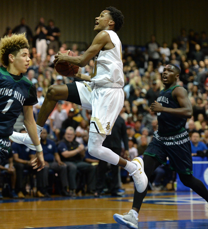 . Bishop Montgomery\'s Gianni Hunt (0) takes the ball behind Chino Hills\' LaMelo Ball (1) in a CIF State Open Division boys basketball game played at El Camino College Tuesday, March 14, 2017, Torrance, CA. Bishop Montgomery won 87-80. Photo by Steve McCrank, Daily News/SCNG