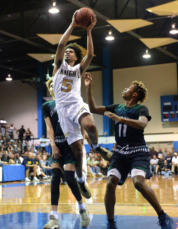 . Bishop Montgomery\'s Ethan Thompson (5) takes it to the bucket over Chino Hills in a CIF State Open Division boys basketball game played at El Camino College Tuesday, March 14, 2017, Torrance, CA. Bishop Montgomery won 87-80. Photo by Steve McCrank, Daily News/SCNG