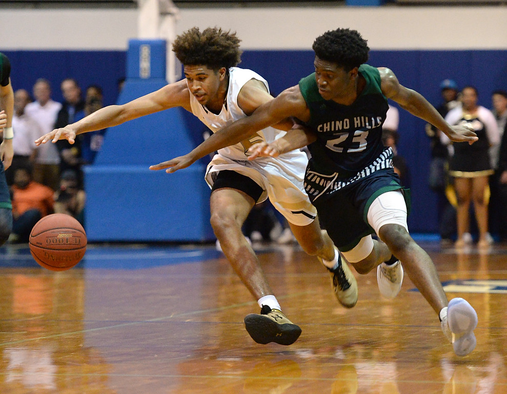 . Bishop Montgomery\'s Ethan Thompson (5) and Chino Hills\' Ofure Ujadughele (23) chase after a loose ball in a CIF State Open Division boys basketball game played at El Camino College Tuesday, March 14, 2017, Torrance, CA. Bishop Montgomery won 87-80. Photo by Steve McCrank, Daily News/SCNG