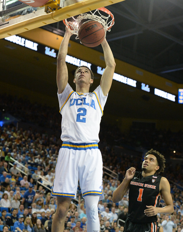 . UCLA\'s Lonzo Ball (2) dunks the ball on a fast break against Oregon State\'s Stephen Thompson Jr (1) in a PAC-12 men\'s basketball game at Pauley Pavilion Sunday, February 12, 2017, Westwood, CA.  UCLA led at the half 32-27. UCLA BRUINS vs. OREGON STATE BEAVERS Photo by Steve McCrank, Daily Breeze/SCNG