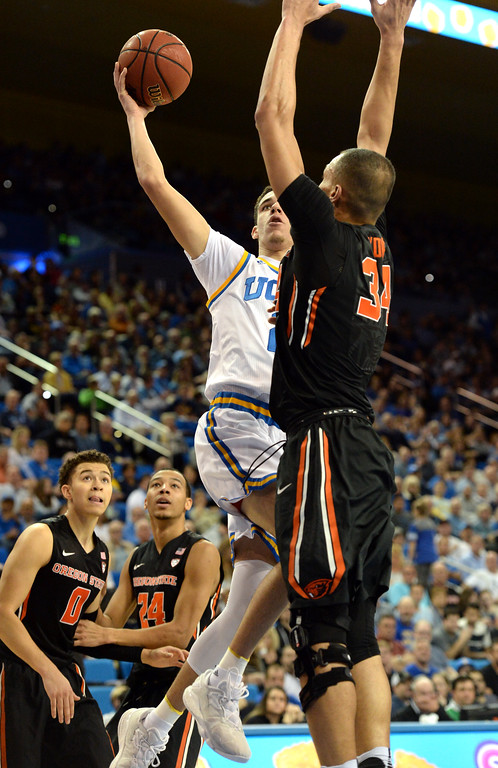 . UCLA\'s Lonzo Ball (2) takes the ball around and over Oregon State\'s Ben Kone (34)  in a PAC-12 men\'s basketball game at Pauley Pavilion Sunday, February 12, 2017, Westwood, CA.  UCLA led at the half 32-27. UCLA BRUINS vs. OREGON STATE BEAVERS Photo by Steve McCrank, Daily Breeze/SCNG