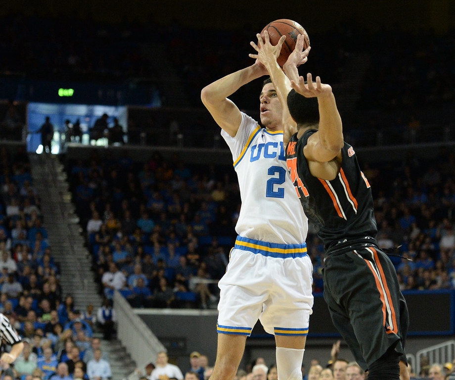 . UCLA\'s Lonzo Ball (2) lines-up a shot over Oregon State\'s Kendal Manuel (24) in a PAC-12 men\'s basketball game at Pauley Pavilion Sunday, February 12, 2017, Westwood, CA.  UCLA led at the half 32-27. UCLA BRUINS vs. OREGON STATE BEAVERS Photo by Steve McCrank, Daily Breeze/SCNG