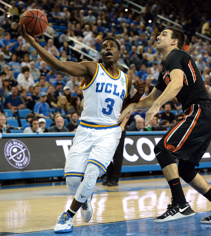 . UCLA\'s Aaron Holiday (3) takes the ball around Oregon State\'s Tanner Sanders (15) in a PAC-12 men\'s basketball game at Pauley Pavilion Sunday, February 12, 2017, Westwood, CA.  UCLA led at the half 32-27. UCLA BRUINS vs. OREGON STATE BEAVERS Photo by Steve McCrank, Daily Breeze/SCNG