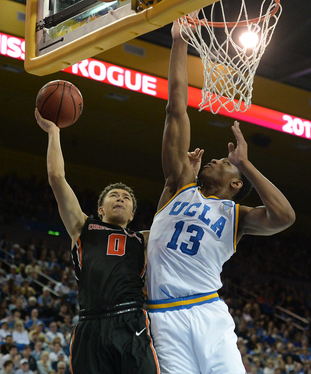 . UCLA\'s Ike Anigbogu (13) goes up to block a shot by Oregon State\'s Jaquori McLaughlin (0) in a PAC-12 men\'s basketball game at Pauley Pavilion Sunday, February 12, 2017, Westwood, CA.  UCLA won 78-60. UCLA BRUINS vs. OREGON STATE BEAVERS Photo by Steve McCrank, Daily Breeze/SCNG
