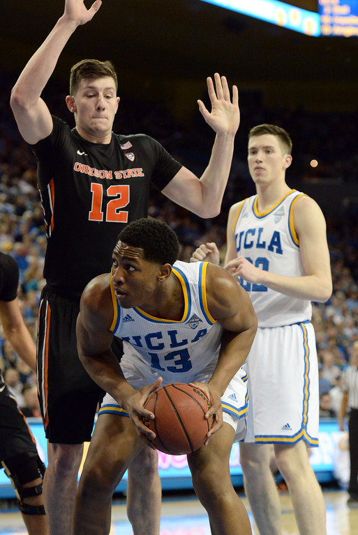 . UCLA\'s Ike Anigbogu (13) battles under the basket against Oregon State\'s Drew Eubanks (12) in a PAC-12 men\'s basketball game at Pauley Pavilion Sunday, February 12, 2017, Westwood, CA.  UCLA led at the half 32-27. UCLA BRUINS vs. OREGON STATE BEAVERS Photo by Steve McCrank, Daily Breeze/SCNG