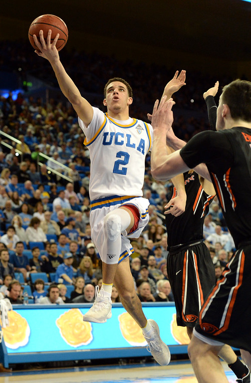 . UCLA\'s Lonzo Ball (2) takes the ball around and over Oregon State\'s  in a PAC-12 men\'s basketball game at Pauley Pavilion Sunday, February 12, 2017, Westwood, CA.  UCLA led at the half 32-27. UCLA BRUINS vs. OREGON STATE BEAVERS Photo by Steve McCrank, Daily Breeze/SCNG