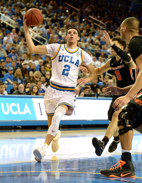 . UCLA\'s Lonzo Ball (2) fakes a drive a shot on basket and would pass outside the key through Oregon State in a PAC-12 men\'s basketball game at Pauley Pavilion Sunday, February 12, 2017, Westwood, CA.  UCLA led at the half 32-27. UCLA BRUINS vs. OREGON STATE BEAVERS Photo by Steve McCrank, Daily Breeze/SCNG