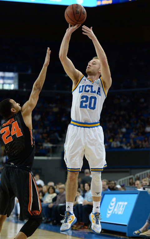 . UCLA\'s Bryce Alford (20) sinks a three point bucket over Oregon State\'s Kendal Manuel (24) in a PAC-12 men\'s basketball game at Pauley Pavilion Sunday, February 12, 2017, Westwood, CA.  UCLA led at the half 32-27. UCLA BRUINS vs. OREGON STATE BEAVERS Photo by Steve McCrank, Daily Breeze/SCNG