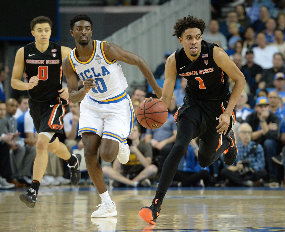 . UCLA\'s Isaac Hamilton (10) chases down Oregon State\'s Stephen Thompson Jr (1) in a PAC-12 men\'s basketball game at Pauley Pavilion Sunday, February 12, 2017, Westwood, CA.  UCLA won 78-60. UCLA BRUINS vs. OREGON STATE BEAVERS Photo by Steve McCrank, Daily Breeze/SCNG