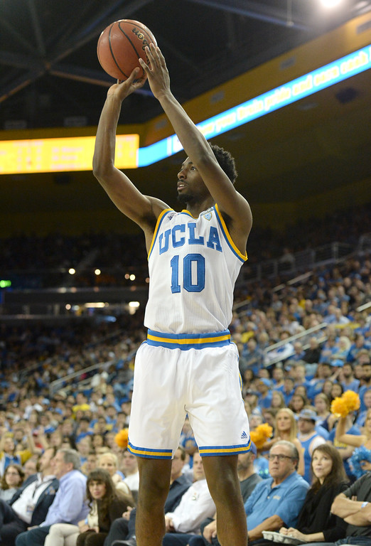 . UCLA\'s Isaac Hamilton (10) hits one from the corner on Oregon State in a PAC-12 men\'s basketball game at Pauley Pavilion Sunday, February 12, 2017, Westwood, CA.  UCLA led at the half 32-27. UCLA BRUINS vs. OREGON STATE BEAVERS Photo by Steve McCrank, Daily Breeze/SCNG