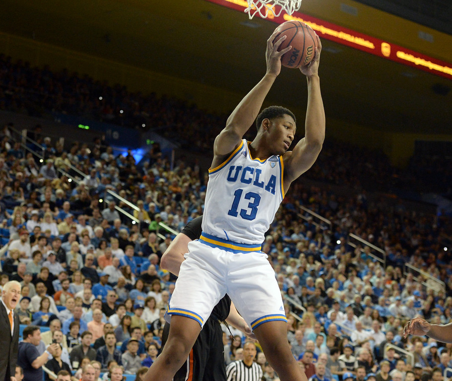 . UCLA\'s Ike Anigbogu (13) pulls down a defensive rebound over Oregon State in a PAC-12 men\'s basketball game at Pauley Pavilion Sunday, February 12, 2017, Westwood, CA.  UCLA won 78-60. UCLA BRUINS vs. OREGON STATE BEAVERS Photo by Steve McCrank, Daily Breeze/SCNG