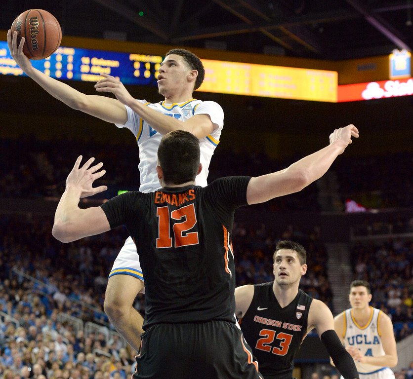 . UCLA\'s Lonzo Ball (10) goes over Oregon State\'s Drew Eubanks (12) in a PAC-12 men\'s basketball game at Pauley Pavilion Sunday, February 12, 2017, Westwood, CA.  UCLA led at the half 32-27. UCLA BRUINS vs. OREGON STATE BEAVERS Photo by Steve McCrank, Daily Breeze/SCNG