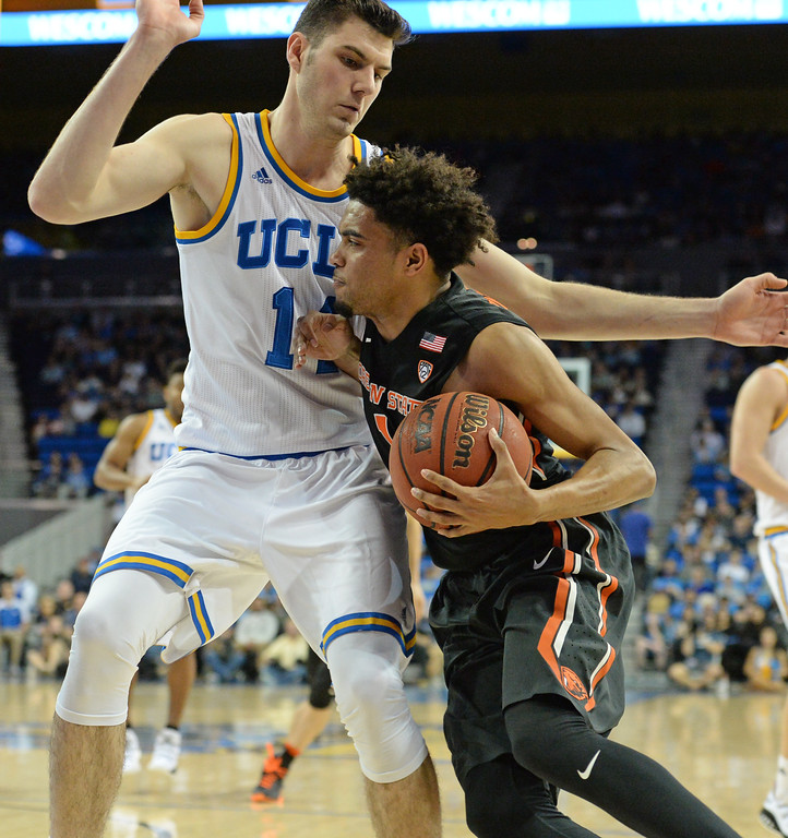 . UCLA\'s Gyorgy Goloman (14) creates an obstacle for Oregon State\'s Stephen Thompson (1) as he drives in a PAC-12 men\'s basketball game at Pauley Pavilion Sunday, February 12, 2017, Westwood, CA.  UCLA won 78-60. UCLA BRUINS vs. OREGON STATE BEAVERS Photo by Steve McCrank, Daily Breeze/SCNG