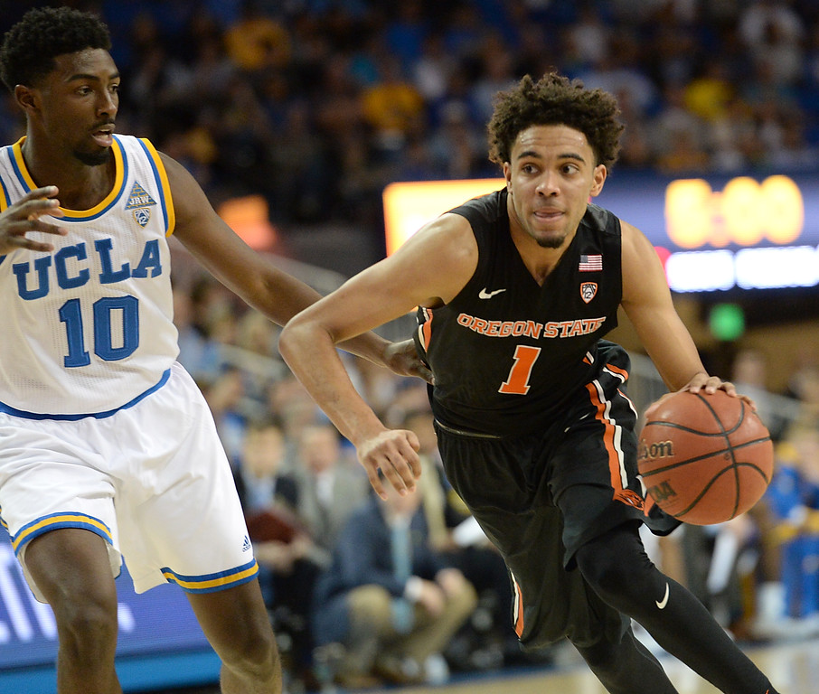 . Oregon State\'s Stephen Thompson Jr (1), former Bishop Montgomery High, drives to the basket against UCLA\'s Isaac Hamilton (10) in a PAC-12 men\'s basketball game at Pauley Pavilion Sunday, February 12, 2017, Westwood, CA.  UCLA won 78-60. UCLA BRUINS vs. OREGON STATE BEAVERS Photo by Steve McCrank, Daily Breeze/SCNG