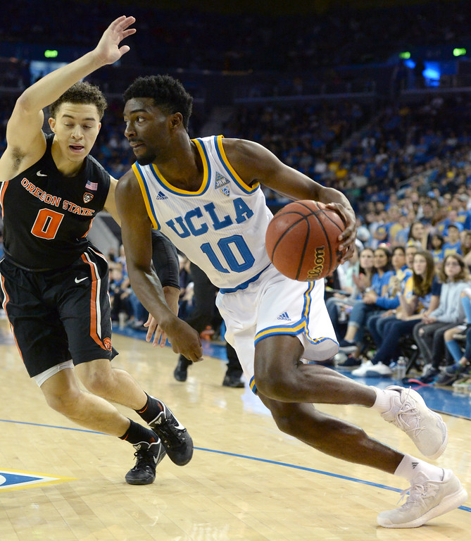 . UCLA\'s Isaac Hamilton (10) drives to the basket against Oregon State\'s Jaquori McLaughlin (0) in a PAC-12 men\'s basketball game at Pauley Pavilion Sunday, February 12, 2017, Westwood, CA.  UCLA led at the half 32-27. UCLA BRUINS vs. OREGON STATE BEAVERS Photo by Steve McCrank, Daily Breeze/SCNG
