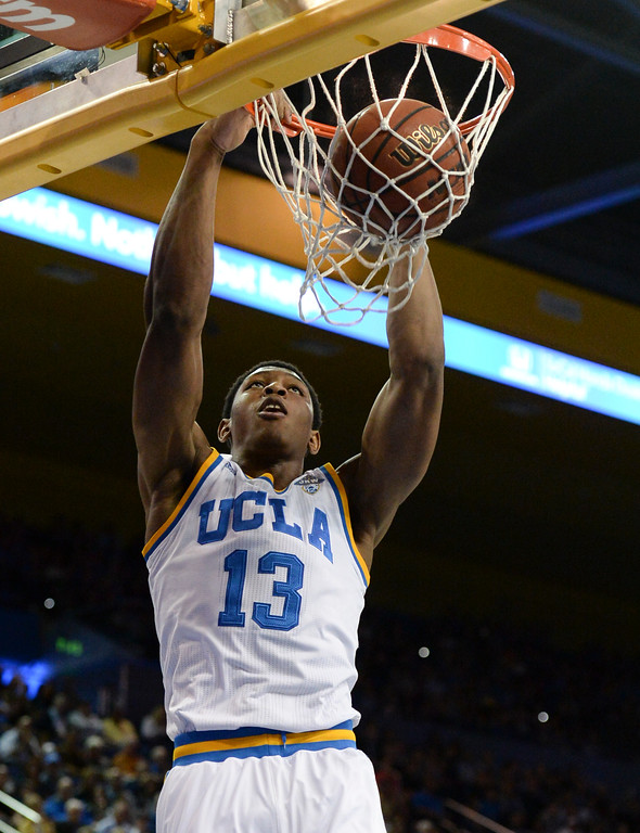 . UCLA\'s Ike Anigbogu (13) throws down a monster dunk on Oregon State in a PAC-12 men\'s basketball game at Pauley Pavilion Sunday, February 12, 2017, Westwood, CA.  UCLA led at the half 32-27. UCLA BRUINS vs. OREGON STATE BEAVERS Photo by Steve McCrank, Daily Breeze/SCNG