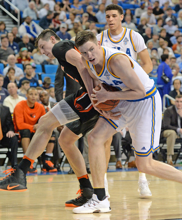 . UCLA\'s TJ Leaf (22) strips the ball from Oregon State\'s Drew Eubanks (12) in a PAC-12 men\'s basketball game at Pauley Pavilion Sunday, February 12, 2017, Westwood, CA.  UCLA won 78-60. UCLA BRUINS vs. OREGON STATE BEAVERS Photo by Steve McCrank, Daily Breeze/SCNG