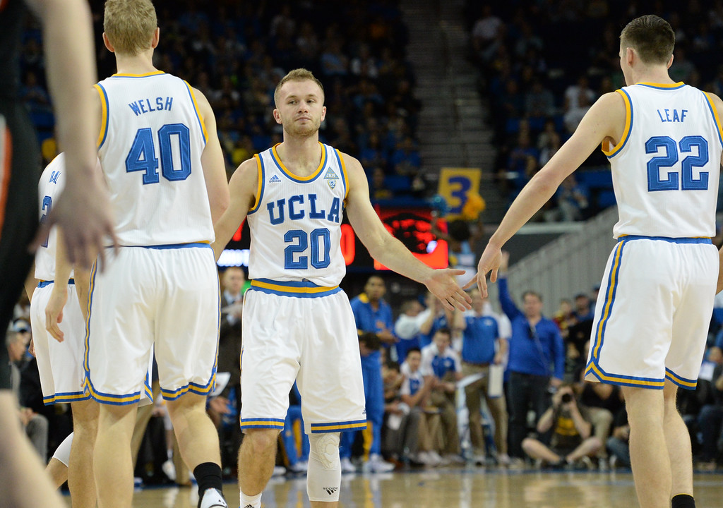 . UCLA\'s Bryce Alford (20) high fives with teammates after putting up four points on Oregon State in a PAC-12 men\'s basketball game at Pauley Pavilion Sunday, February 12, 2017, Westwood, CA.  UCLA led at the half 32-27. UCLA BRUINS vs. OREGON STATE BEAVERS Photo by Steve McCrank, Daily Breeze/SCNG