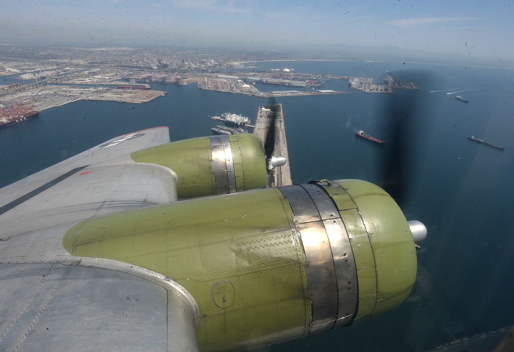 . The Liberty Foundation is bringing the WWII era B-17 bomber aircraft to the Long Beach Daugherty Field Airport for it\'s 2017 Salute to Veterans tour Monday, April 10, 2017, Long Beach.   The public can buy flights on the airplane Saturday and Sunday April 15-16, or take a ground tour for free. Two of the four massive, propped engines churn the plane over the harbor. (Photo by Steve McCrank, Press Telegram/SCNG)