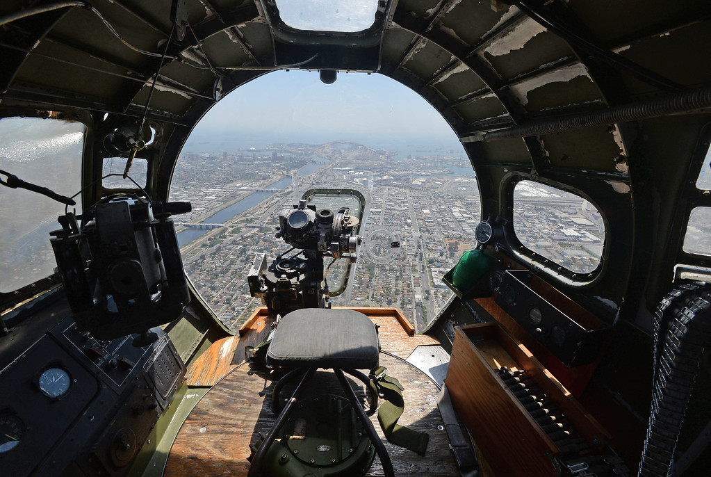 . The Liberty Foundation is bringing the WWII era B-17 bomber aircraft to the Long Beach Daugherty Field Airport for it\'s 2017 Salute to Veterans tour Monday, April 10, 2017, Long Beach.   The public can buy flights on the airplane Saturday and Sunday April 15-16, or take a ground tour for free.  The bombardier\'s view from the plexiglass nose with the Norden bombsight in the foreground. (Photo by Steve McCrank, Press Telegram/SCNG)