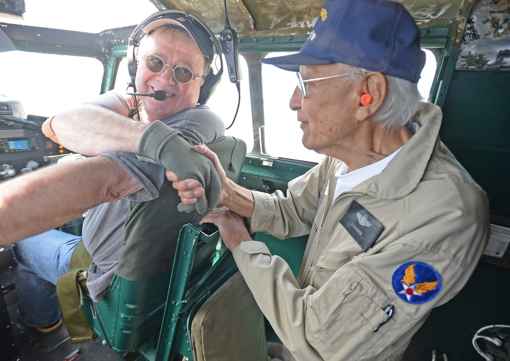 . The Liberty Foundation is bringing the WWII era B-17 bomber aircraft to the Long Beach Daugherty Field Airport for it\'s 2017 Salute to Veterans tour Monday, April 10, 2017, Long Beach.   The public can buy flights on the airplane Saturday and Sunday April 15-16, or take a ground tour for free.  US Army Air Corp 100th Bomb Group co-pilot Hank Cervantes, right, shakes hands with pilot Bob Hill, left, as he takes a ride aboard the B-17, which was the same aircraft he co-piloted over Germany during WWII. Cervantes and his crew survived an intentional collision by a German airplane which nearly severed the tail of the aircraft. (Photo by Steve McCrank, Press Telegram/SCNG)