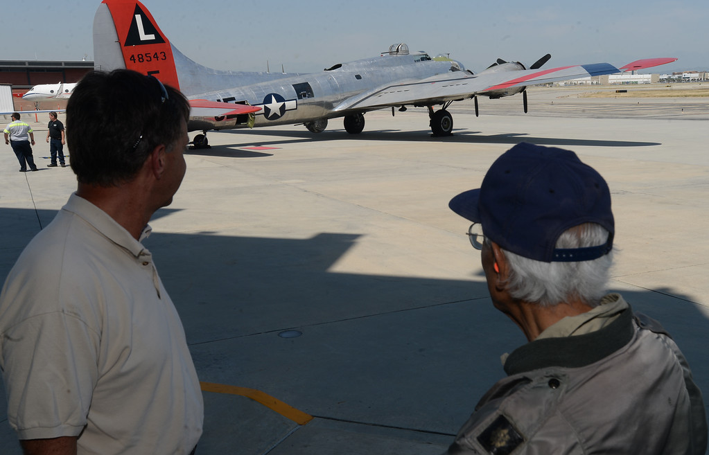 . The Liberty Foundation is bringing the WWII era B-17 bomber aircraft to the Long Beach Daugherty Field Airport for it\'s 2017 Salute to Veterans tour Monday, April 10, 2017, Long Beach.   The public can buy flights on the airplane Saturday and Sunday April 15-16, or take a ground tour for free.  US Army Air Corp 100th Bomb Group co-pilot Hank Cervantes, right, shares stories with pilot Dave Lyon, right, after a ride aboard the B-17, which was the same aircraft he co-piloted over Germany during WWII. Cervantes and his crew survived an intentional collision by a German airplane which nearly severed the tail of the aircraft. (Photo by Steve McCrank, Press Telegram/SCNG)