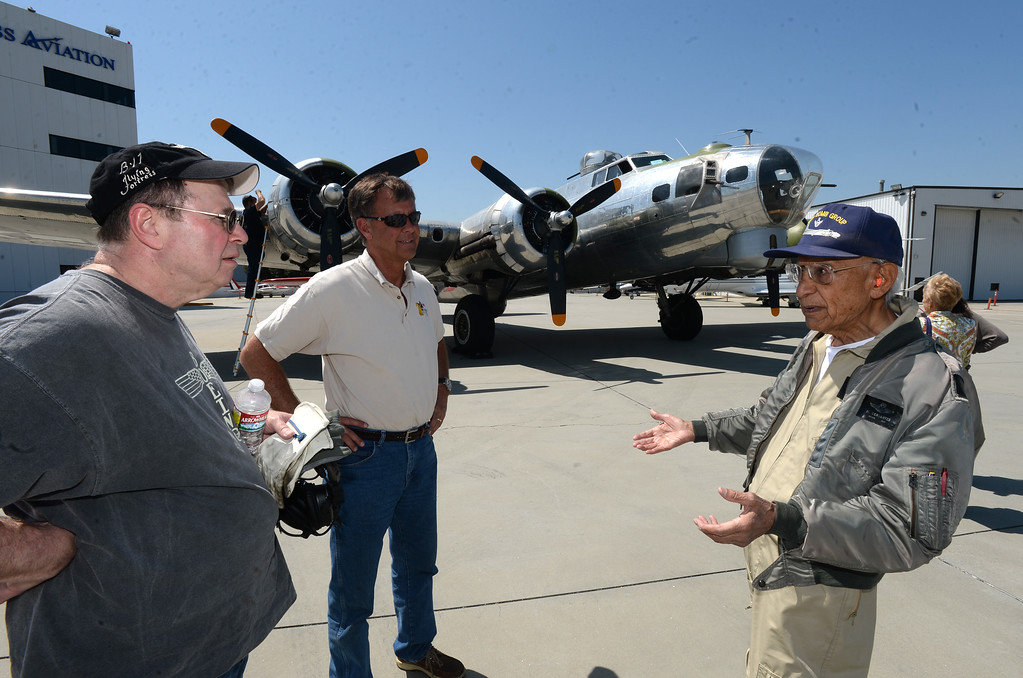 . The Liberty Foundation is bringing the WWII era B-17 bomber aircraft to the Long Beach Daugherty Field Airport for it\'s 2017 Salute to Veterans tour Monday, April 10, 2017, Long Beach.   The public can buy flights on the airplane Saturday and Sunday April 15-16, or take a ground tour for free.  US Army Air Corp 100th Bomb Group co-pilot Hank Cervantes, right, shares stories with pilot Bob Hill, left,  and Dave Lyon, right, after a ride aboard the B-17, which was the same aircraft he co-piloted over Germany during WWII. Cervantes and his crew survived an intentional collision by a German airplane which nearly severed the tail of the aircraft. (Photo by Steve McCrank, Press Telegram/SCNG)