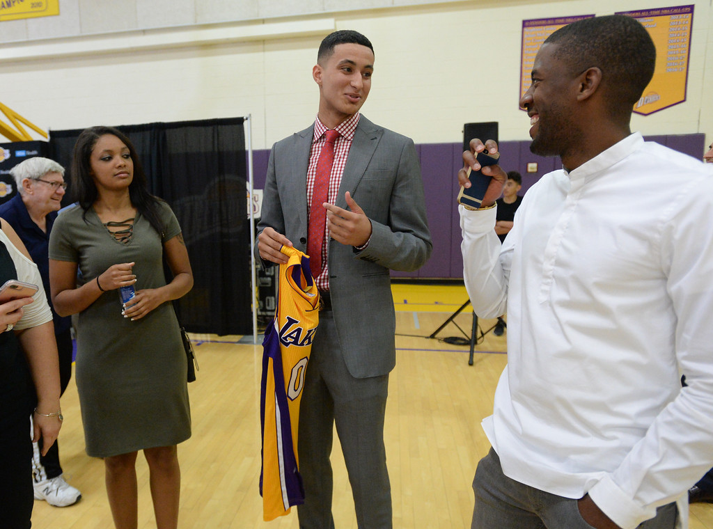 . The Los Angeles Lakers introduced three more players drafted to the team that include, from right: Josh Hart (Villanova), Kyle Kuzma (Utah) and Thomas Bryant (Indiana) during a press conference at the Lakers\' training facility Thursday, June 29, 2017, El Segundo, CA.    Kuzma shares a laugh after the conference. (Photo by Steve McCrank, Daily Breeze/SCNG)