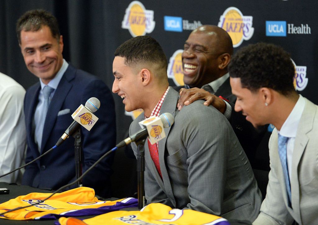 . The Los Angeles Lakers introduced three more players drafted to the team that include, from right: Josh Hart (Villanova), Kyle Kuzma (Utah) and Thomas Bryant (Indiana) during a press conference at the Lakers\' training facility Thursday, June 29, 2017, El Segundo, CA.   Both hailing from Michigan, Kyle Kuzma, center, and Magic Johnson share a laugh as Kuzma reminisces about watching Magic play, when he was a child, and how the shorts were extra short in that era. (Photo by Steve McCrank, Daily Breeze/SCNG)