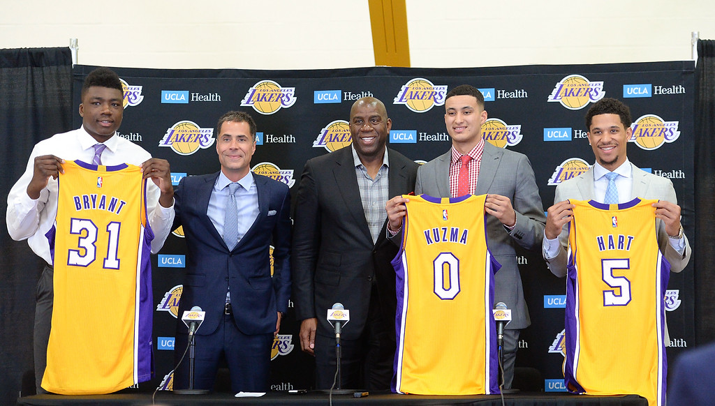 . The Los Angeles Lakers introduced three more players drafted to the team that include, from right: Josh Hart (Villanova), Kyle Kuzma (Utah), President of Basketball Operations Magic Johnson, General Manager Rob Pelinka and Thomas Bryant (Indiana) during a press conference at the Lakers\' training facility Thursday, June 29, 2017, El Segundo, CA.   (Photo by Steve McCrank, Daily Breeze/SCNG)