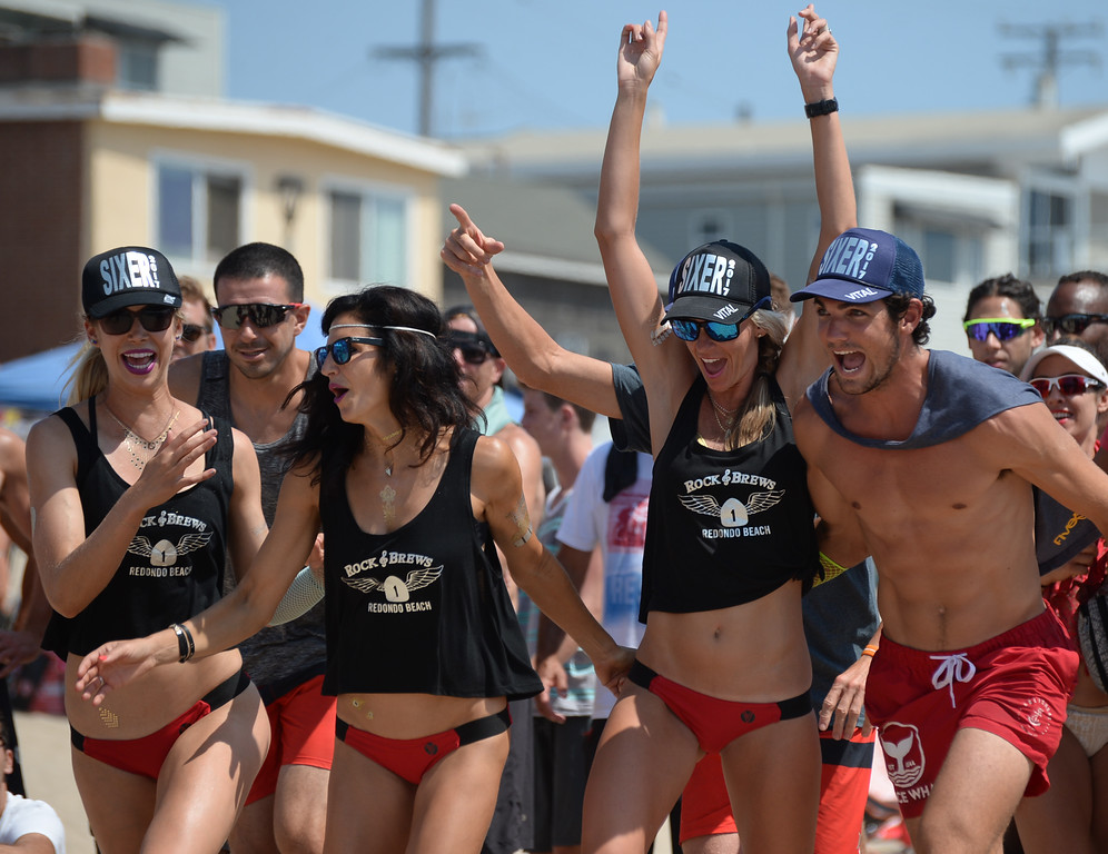. Rock & Brews rushes the court to celebrate a point in the finals of the Charlie Saikley 6-Man Beach Volleyball tournament Saturday, August 05, 2017, Manhattan Beach, CA.  Team Fletch won the men\'s open competition and Horny Unicorny won the women\'s, with Rock & Brews second. (Photo by Steve McCrank, Daily Breeze/SCNG)